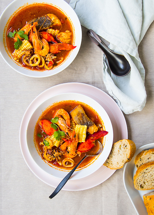 Peruvian Influenced seafood soup with tomatoes and chilli pastes
