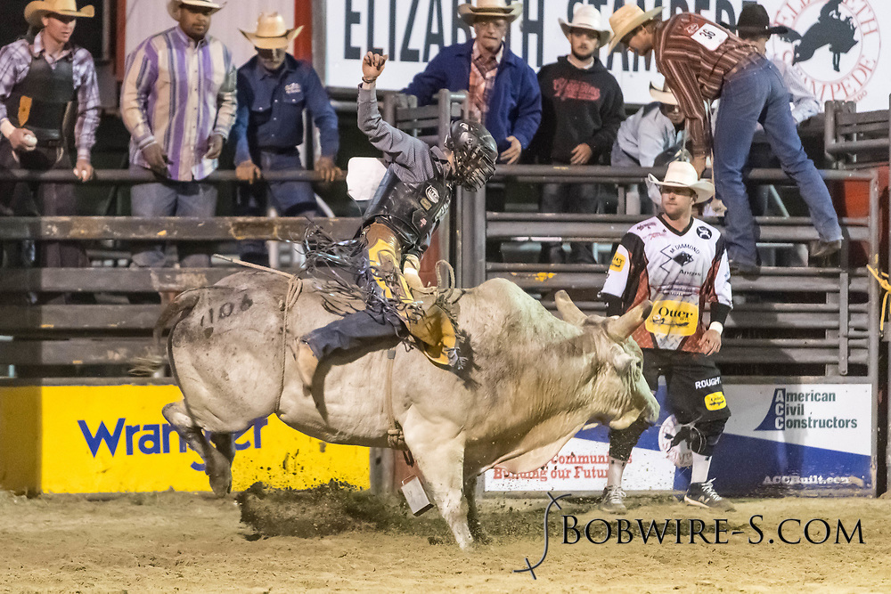 Bull rider Brandon Olson rides Summit Pro Rodeo's Ice Baby in the second performance of the Elizabeth Stampede on Saturday, June 2, 2018.