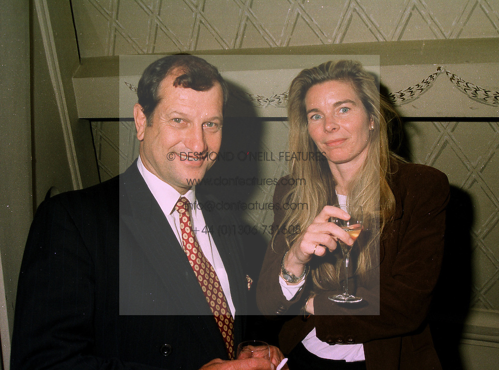Former top jockey BOB CHAMPION and MRS LUCY WILKINSON,  at a reception in London on 22nd May 1997.LYL 8