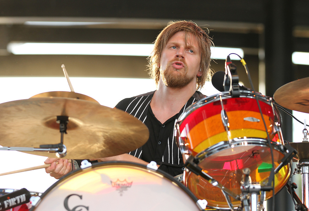 Arnar R&oacute;senkranz Hilmarsson, drummer for the band Of Monsters and Men performs at the Farm Bureau Insurance Lawn at White River State Park Thursday May 30, 2013. The concert was the first of the season for the venue.  <br /> Chris Bergin/ for The Star