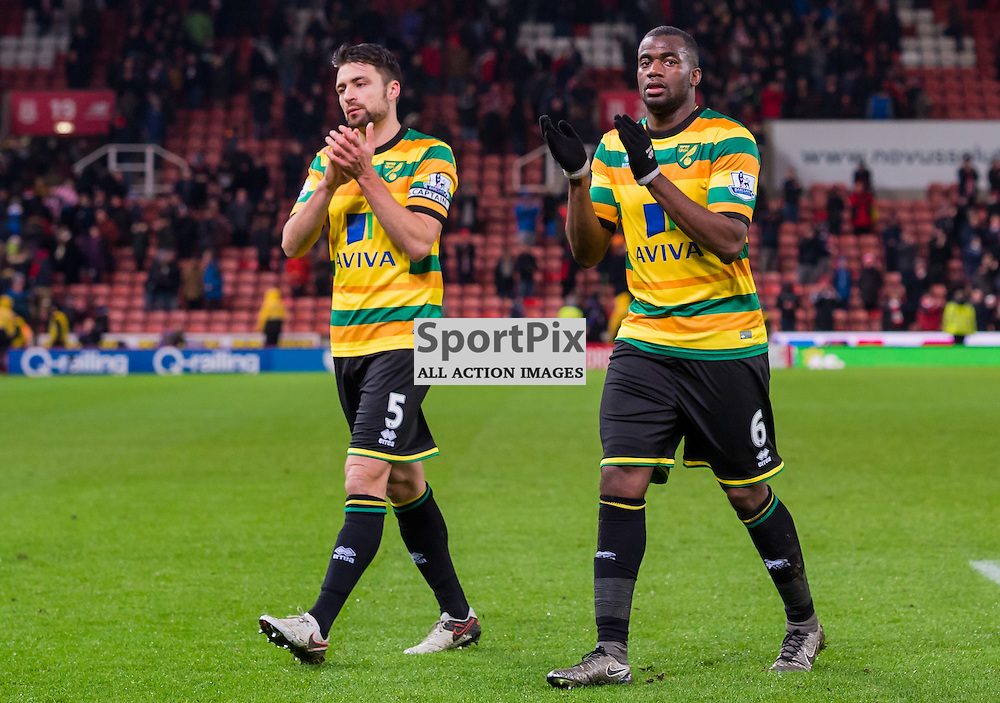 Norwich City defender Russell Martin (5)  and Norwich City defender Sebastien Bassong (6)  salute their travelling support