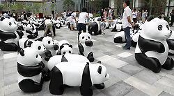 61633273<br /> Lovely pandas are seen during the 1St panda exhibition at Kerry Centre Square in Shanghai, East China, June 2, 2014. A total of 100 pandas made of leftover moso bamboos were displayed during the exhibition, Monday, 2nd June 2014. Picture by  imago / i-Images<br /> UK ONLY