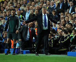 Guus Hiddink argues with the fourth official during the UEFA Champions League Quarter Final Second Leg match between Chelsea and Liverpool at Stamford Bridge on April 14, 2009 in London, England.