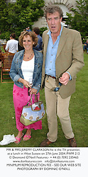 MR & MRS JEREMY CLARKSON he is the TV presenter, at a lunch in West Sussex on 27th June 2004.PWM 212