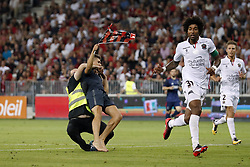 (L-R)  pitch intruder, steward, Dante of OCG Nice, Vincent Koziello of OCG Nice, during the UEFA Champions League third round qualifying first leg match between OGC Nice and Ajax Amsterdam on July 26, 2017 at the Allianz Riviera in Nice, France