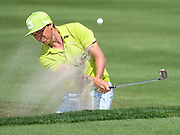 March 20, 2014 - Orlando, FL, U.S: Rickie Fowler hits out of the green side bunker on 6 during first round golf action of the Arnold Palmer Invitational presented by Mastercard held at Arnold Palmer's Bay Hill Club & Lodge in Orlando, FL