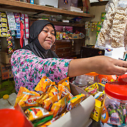 CAPTION: Khoiriyah runs a small shop at the entrance to her house. With adequate warning time, she is able to store all of her produce safely away from advancing floodwater. LOCATION: Wonosari, Semarang, Indonesia. INDIVIDUAL(S) PHOTOGRAPHED: Khoiriyah.