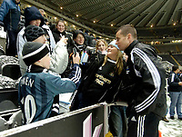 Photo: Jed Wee.<br />Newcastle United v Charlton Athletic. The Barclays Premiership. 28/12/2005.<br />Fans have to content themselves with autographs as the match is called off, as Shay Given stops to sign some.