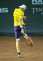 April 13, 2018 - Houston, TX, U.S. - HOUSTON, TX - APRIL 13:  John Isner of the United States cleans off his shoes in the match against Steve Johnson of the United States during the Quarterfinal round of the Men's Clay Court Championship on April 13, 2018 at River Oaks Country Club in Houston, Texas.  (Photo by Leslie Plaza Johnson/Icon Sportswire) (Credit Image: © Leslie Plaza Johnson/Icon SMI via ZUMA Press)