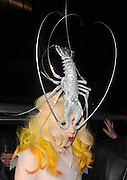 27.FEBUARY.2010 - LONDON<br /> <br /> LADY GAGA ARRIVING ARRIVING AT MR.CHOW'S RESTAURANT IN KNIGHTSBRIDGE WEARING A SEE THROUGH PLASTIC DRESS WITH A BIG SILVER LOBSTER ON HER HEAD AFTER PERFORMING AT THE O2 ARENA IN GREENWICH AS PART OF HER WORLD TOUR.<br /> <br /> BYLINE: EDBIMAGEARCHIVE.COM<br /> <br /> *THIS IMAGE IS STRICTLY FOR UK NEWSPAPERS & MAGAZINES ONLY* <br /> *FOR WORLD WIDE SALES OR WEB USE PLEASE CONTACT EDBIMAGEARCHIVE - 0208 954 5968*