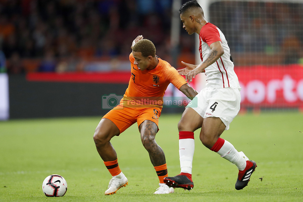 (L-R) Memphis Depay of Holland, Anderson Santamaria of Peru during the International friendly match match between The Netherlands and Peru at the Johan Cruijff Arena on September 06, 2018 in Amsterdam, The Netherlands