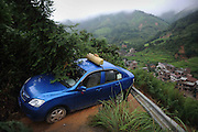 LANSHAN, CHINA - (CHINA OUT)<br /> <br /> A truck hangs over a road edge at a landslide-hit area  in Lanshan County, Hunan Province of China. Floods and mudslides triggered by typhoon Utor have killed 9 people in Hunan province<br /> ©Exclusivepix