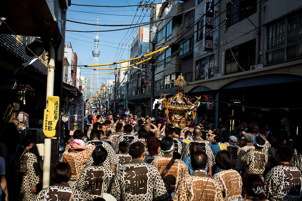 TOKYO, JAPAN - MAY 15: The residents of Asakusa band together to carry a 'mikoshi' (portable shrines) through the streets of Asakusa during the second day of Sanja Festival in Tokyo, Japan on May 15, 2016. These 'mikoshi' (portable shrine) is carried in the streets of Asakusa to bring good luck, blessings and prosperity to the area and its inhabitants.<br /> <br /> Photo: Richard Atrero de Guzman