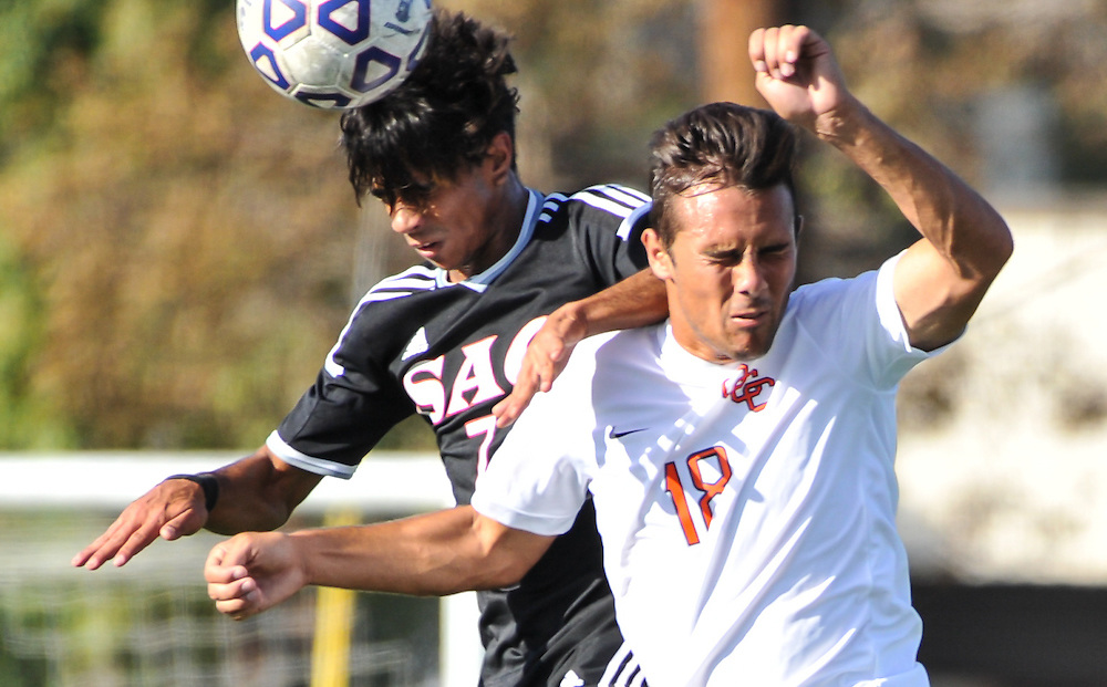 11/4/16 3:35:41 PM Santa Ana College Don midfielder Matheus Cuhna (7) heads the ball while fighting off Orange Coast College Pirate defender Taylor Kane (18) during the first half of the match between Orange Coast College and Santa Ana College, on the campus of Santa Ana College, Santa Ana, CA<br /> <br /> Photo by Joshua D. McKee