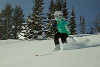 Jessica Laman (age 9) skiing fresh powder snow in Jackson Hole, Wyoming