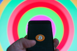 A bitcoin logo is seen on an iPhone in this photo illustration on December 15, 2017. (Photo by Jaap Arriens/Sipa USA)