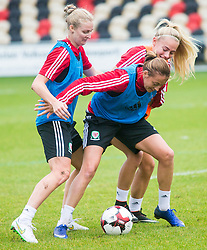NEWPORT, WALES - Monday, September 19, 2016: Wales' Kayleigh Green, Rhiannon Roberts and Charlie Estcourt warm up ahead of the UEFA Women's Euro 2017 Qualifying Group 8 match at Rodney Parade. (Pic by Laura Malkin/Propaganda)