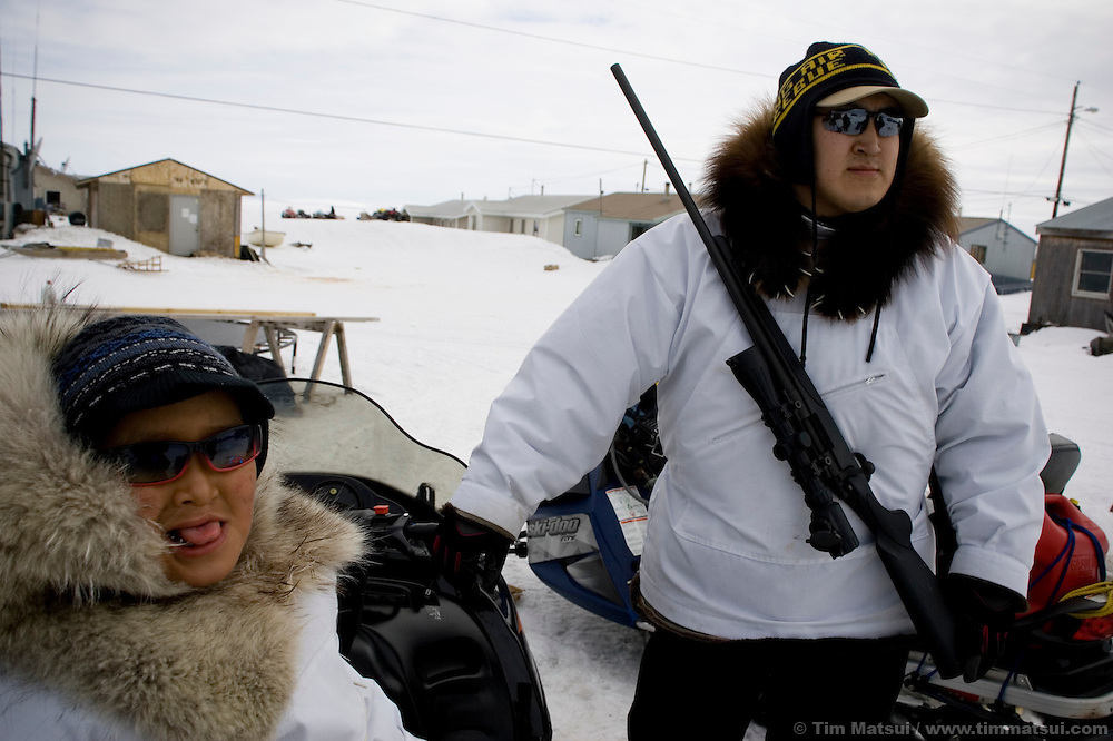 May 3, 2008 -- Kivalina, AK, U.S.A..Gary Swan, with his six year-old son Terrell, prepares to head out to his father's whaling camp twelve miles from the 400 person native village of Kivalina, Alaska, and some two mile out onto melting pack ice. Kivalina is suing 20 oil companies for property damage related to global warming; the ocean pack ice forms later and melts earlier, leaving the town vulnerable to erosive winter storms and endangering their traditional subsistence lifestyle. (Photo by Tim Matsui)