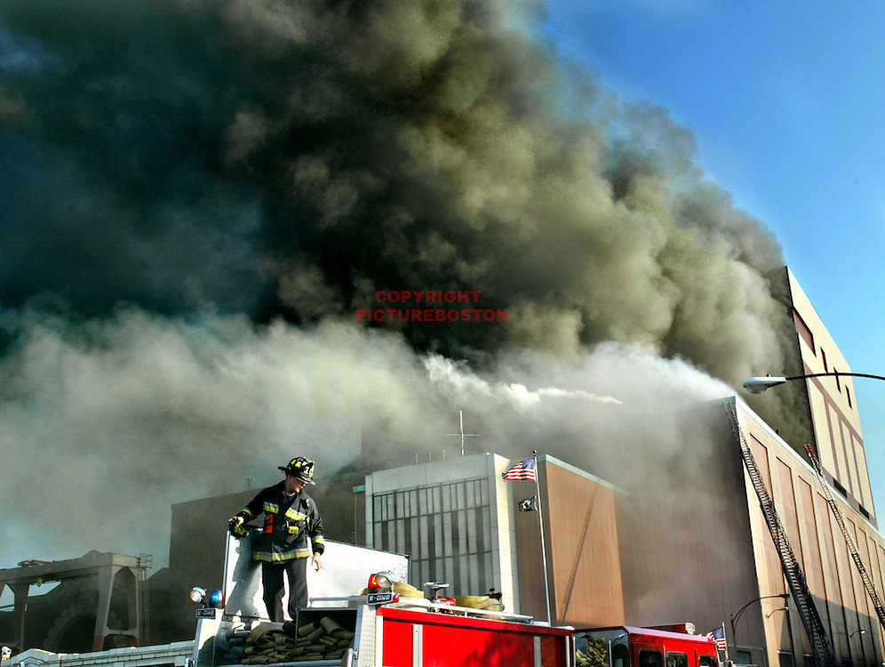 """Power Plant Fire' Firefighters arrive at scene of 9 Alarm fire at Summer street power station."