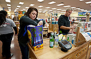 Chad Wilkinson, left, and Pamela Ramos, practice checking out items at the Trader Joe's location on 400 South and 600 East, opening this Friday at 8:00am , Tuesday, Nov. 27, 2012.