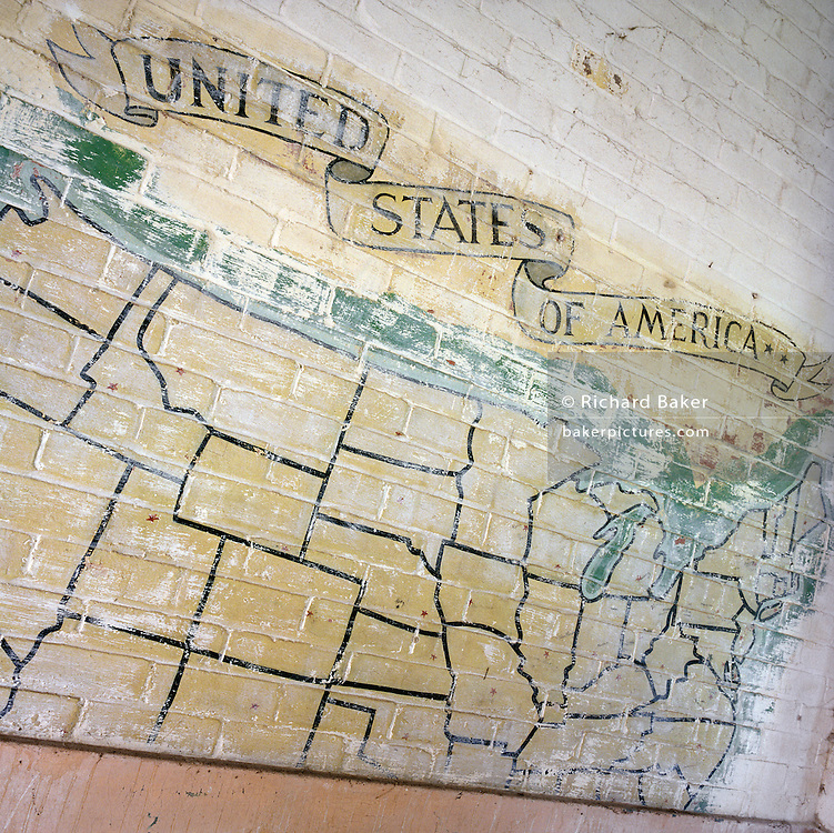 WW2 wall map mural showing American states at the former Flixton air force base in Suffolk, England. Flixton was the home of the 706th Bombardment Squadron, an operational squadron of the 446th Bombardment Group (Heavy). The 446th operated chiefly against strategic objectives on the Continent from December 1943 until April 1945. Targets included U-boat installations at Kiel, the port at Bremen, a chemical plant at Ludwigshafen, ball-bearing works at Berlin, aero-engine plants at Rostock, aircraft factories at Munich, marshalling yards at Coblenz, motor works at Ulm, and oil refineries at Hamburg. After the war, the buildings reverted to agricultural and industrial use.