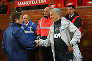 Burton Albion manager Nigel Clough and Manchester United Manager Jose Mourinho shake hands during the EFL Cup match between Manchester United and Burton Albion at Old Trafford, Manchester, England on 19 September 2017. Photo by John Potts.