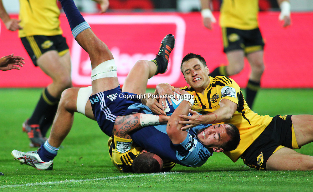 Blues' loose forward Chris Lowrey is held up from scoring by Tim Bateman during their Super Rugby match, Hurricanes v Blues, Westpac stadium, Wellington, New Zealand. Friday 4 May 2012.  PHOTO: Grant Down / photosport.co.nz