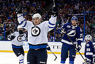 Winnipeg Jets' Bryan Little celebrates his goal in front of Tampa Bay Lightning's Victor Hedman (77) and goalie Anders Lindback during the third period of their NHL hockey game in Tampa, Florida, March 7, 2013.  REUTERS/Mike Carlson (UNITED STATES)
