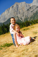 Summer family portraits with the Thompson family on a beautiful sunny day at the Canmore Nordic Centre Provincial Park<br /> <br /> ©2017, Sean Phillips<br /> http://www.RiverwoodPhotography.com