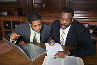 Two men working in court