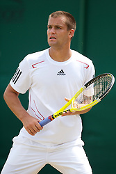 LONDON, ENGLAND - Friday, June 25, 2010: Mikhail Youzhny (FRA) during the Gentlemen's Singles 2nd Round on day five of the Wimbledon Lawn Tennis Championships at the All England Lawn Tennis and Croquet Club. (Pic by David Rawcliffe/Propaganda)
