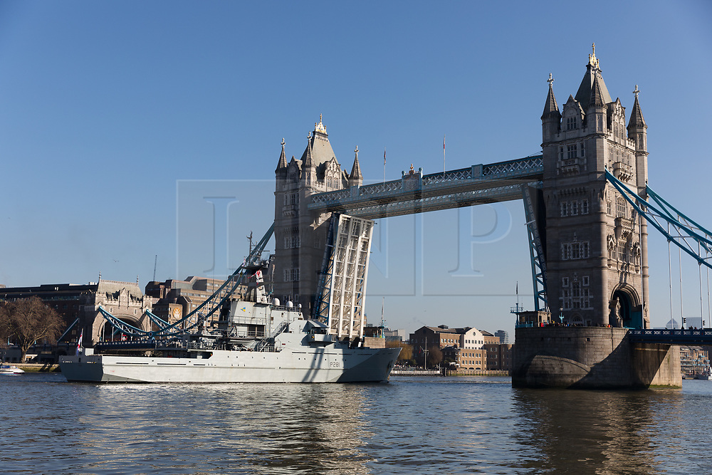 © Licensed to London News Pictures. 06/02/2020. London, UK. HMS Tyne leaves central London on the River Thames under Tower Bridge following a three day central London visit. HMS Tyne is one of the three River-class patrol ships built to safeguard the fishing stocks and enforce national and EU fisheries legislation within British Fishery Limits, including protecting and patrolling in the Strait of Gibraltar. Along with HMS Severn and HMS Mersey, the fleet of three make up the Fishery Protection Squadron – the 'Cod Squad' – the oldest unit in the Royal Navy. Photo credit: Vickie Flores/LNP