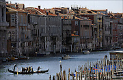 "SHOT 3/7/2006 - Venice is one of Italy's most beautiful and romantic cities, built on the water in a lagoon. Venice has many magnificent churches and palaces, lively squares, and interesting shops. It is one of the biggest travel destinations in Italy. Venice is also home of one of the biggest Carnevale celebrations in Italy. The 150 canals of Venice are its streets - roads for land passenger vehicles are nonexistent. Everyone must travel by foot or boat, tourists and locals alike. The Grand Canal (Italian: Canal Grande) is the most important canals in Venice, Italy. It forms one of the major water-traffic corridors in the city. Public transportation is provided by the water bus and by private water taxis. The GRand Canal of Venice runs through most of the city, it ""starts"" from the lagoon near the train station, makes a large S-shape through the central districts, the ""sestiere"" of Venice, and ends at the Basilica di Santa Maria della Salute, near Piazza San Marco (Saint Mark's Square), with an average depth of five meters. Its banks are lined with some of the most beautiful buildings of the city, amongst the many structures are Ca' Rezzonico, Ca d'Oro, Ca' Foscari, Palazzo Venier dei Leoni, housing the Peggy Guggenheim Collection, as well as both Pallazi from the two branches of the noble Barbaro family. Some of the churches along the canal include Basilica di Santa Maria della Salute and Il Redentore..(MARC PISCOTTY/ © 2006)"
