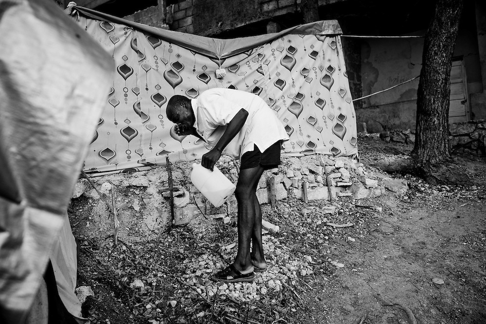 A man washes his face in a camp for those displaced by the recent earthquake in Petionville, outside Port-au-Prince, Haiti.