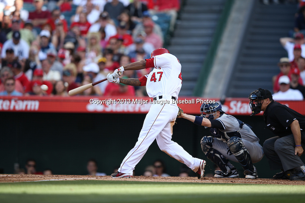 ANAHEIM, CA - JUNE 15:  Howie Kendrick #47 of the Los Angeles Angels of Anaheim hits a leadoff single in the bottom of the 4th inning during the game against the New York Yankees on Saturday, June 15, 2013 at Angel Stadium in Anaheim, California. The Angels won the game 6-2. (Photo by Paul Spinelli/MLB Photos via Getty Images) *** Local Caption *** Howie Kendrick
