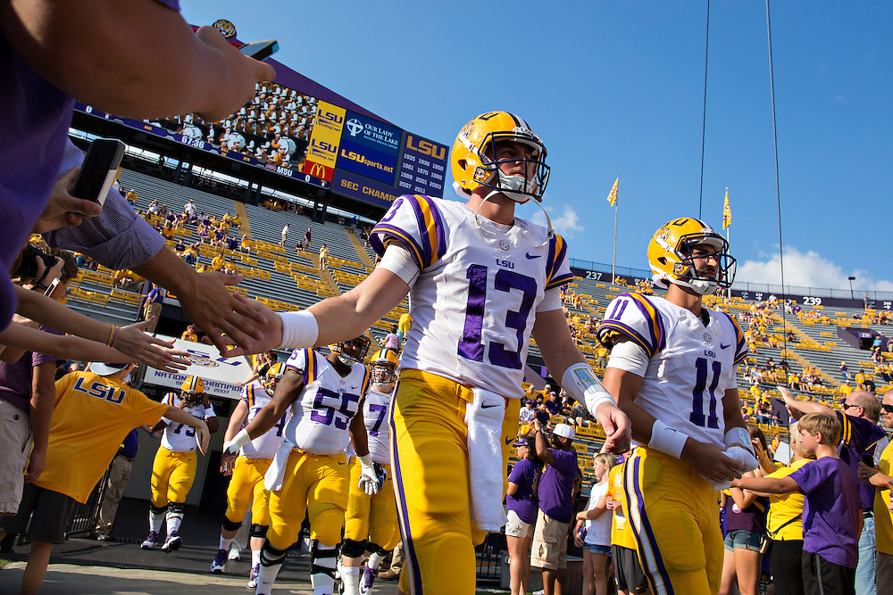 BATON ROUGE, LA - SEPTEMBER 20: Jake Clise #13 of the LSU Tigers walks onto the field before a game against the Mississippi State Bulldogs at Tiger Stadium on September 20, 2014 in Baton Rouge, Louisiana.  The Bulldogs defeated the Tigers 34-29.  (Photo by Wesley Hitt/Getty Images) *** Local Caption *** Jake Clise