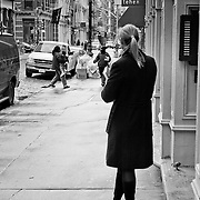 Young girl having a smoke in Soho district.