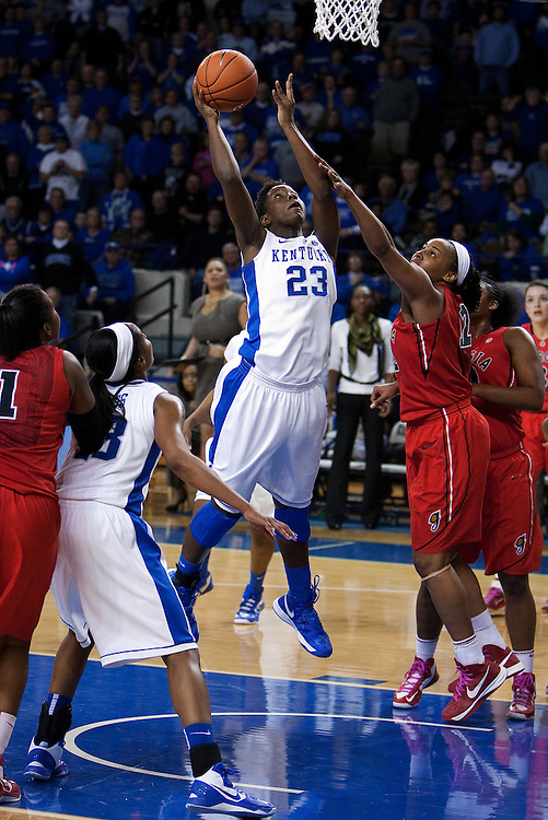 UK forward/center Samarie Walker, center, goes to the basket with pressure from Georgia forward Jasmine Hassell in the second half. The University of Kentucky Women's Basketball team hosted Georgia, Sunday, Feb. 03, 2013 at Memorial Coliseum in Lexington.