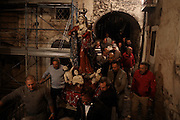 Men carry a statue of the Virgin Mary during a procession of a religious ceremony held every year to bless shepherds who would, at the beginning of the winter, walk with their herds to the south of Italy for warmer weather, Castel del Monte, in the province of L'Aquila in Abruzzo.