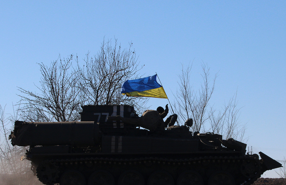 An armored vehicle drives away from Debaltseve, Ukraine on February 18, 2015 on a road about 30 kilometers from the city. Wednesday saw a steady stream of vehicles leaving the embattled city, which had apparently fallen to separatist forces.