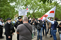 © Licensed to London News Pictures. 16/05/2020. London, UK. Anti lockdown demonstrators gather in Hyde Park London to protest against the ongoing restrictions imposed to fight the spread of COVID-19. Government has announced a series of measures to slowly ease lockdown, which was introduced to fight the spread of the COVID-19 strain of coronavirus. Photo credit: Ben Cawthra/LNP