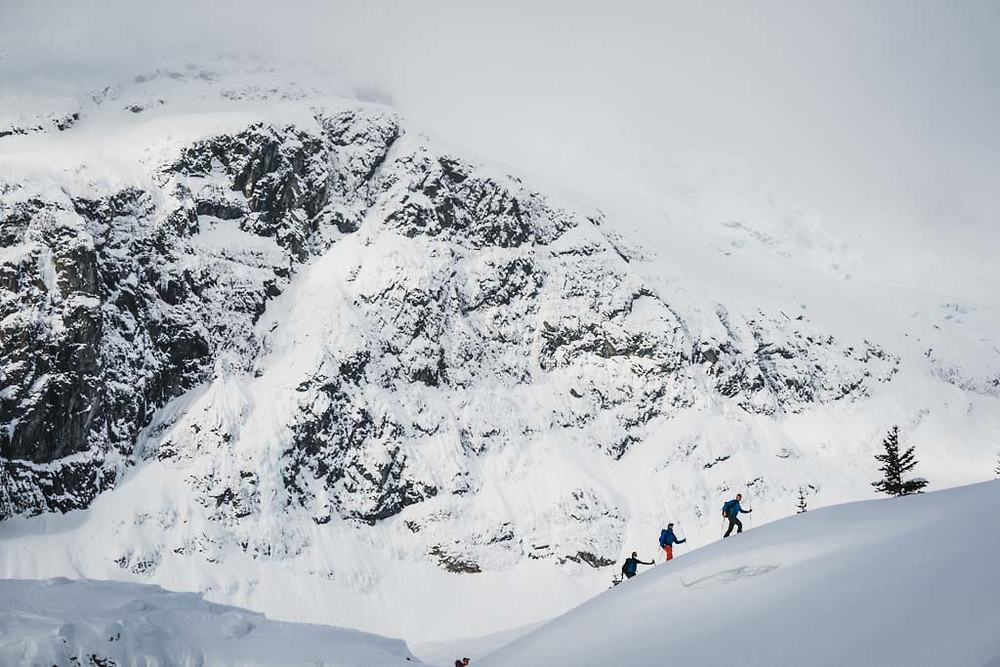 Sean Fraser, Joe Morabito, and Erme Catino below the flanks of Hut Peak, Howson Range, British Columbia.