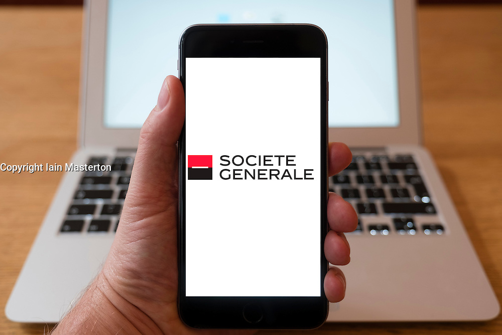 Using iPhone smartphone to display logo of Society General , the French multinational banking and financial services company