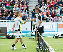 LIVERPOOL, ENGLAND - Saturday, June 23, 2012: Kevin Anderson (RSA) shakes hands with Lukas Lacko (SVK) after winning the Men's Final on day three of the Medicash Liverpool International Tennis Tournament at Calderstones Park. (Pic by David Rawcliffe/Propaganda)