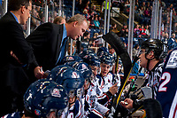 KELOWNA, CANADA - OCTOBER 27: Tri-City Americans' head coach Mike Williamson speaks to linesman Kevin Crowell from the bench against the Kelowna Rockets on October 27, 2017 at Prospera Place in Kelowna, British Columbia, Canada.  (Photo by Marissa Baecker/Shoot the Breeze)  *** Local Caption ***