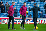 Heart of Midlothian goalkeeping coach Paul Gallacher (right) speaks with Zdenek Zlamal (#1) of Heart of Midlothian FC (left) and Joel Pereira (#23) of Heart of Midlothian FC (centre)before the Ladbrokes Scottish Premiership match between Rangers FC and Heart of Midlothian FC at Ibrox Park, Glasgow, Scotland on 1 December 2019.
