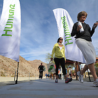 A group of participants walk along Bear Creek Trail in the Well-Being Walk event during Humana Challenge week in La Quinta, Calif., Saturday, January 14, 2012. (Eric Reed/AP Images for Humana)