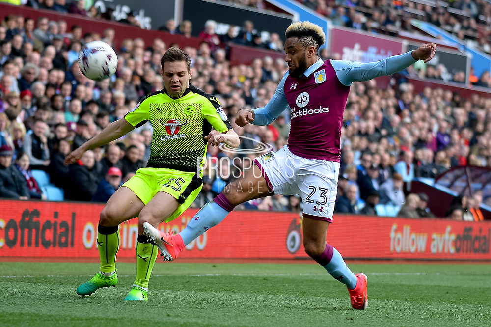 Aston Villa defender Jordan Amavi (23) clears under pressure from Reading midfielder Adrian Popa (25) during the EFL Sky Bet Championship match between Aston Villa and Reading at Villa Park, Birmingham, England on 15 April 2017. Photo by Dennis Goodwin.