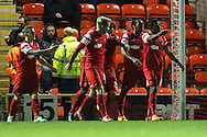 Jay Simpson of Leyton Orient (2nd right) 2celebrates scoring the opening goal against Northampton Town with team mates during the Johnstone's Paint Trophy match at the Matchroom Stadium London,<br /> Picture by David Horn/Focus Images Ltd +44 7545 970036<br /> 11/11/2014