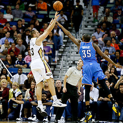 Dec 2, 2014; New Orleans, LA, USA; New Orleans Pelicans forward Ryan Anderson (33) shoots over Oklahoma City Thunder forward Kevin Durant (35) during the second half of a game at the Smoothie King Center. The Pelicans defeated the Thunder 112-104. Mandatory Credit: Derick E. Hingle-USA TODAY Sports